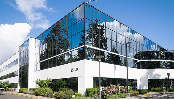 A commcercial office building on a sunny day.